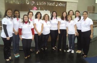Parte da equipe de profissionais voluntários do Promai.