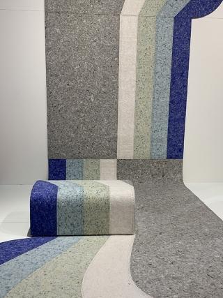 Patricia Urquiola a arquiteta e designer trabalhou com carpete reciclado inovando nas formas orgânicas e cores.